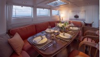 29 Royal Huisman Sailing Yacht Pumula - main deckhouse dining - Photo by Cory Silken