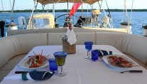 Al fresco dining aboard Aspiration yacht for charter