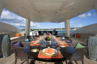 Motor yacht DENIKI - Sun Deck Dining with a flat screen TV above table