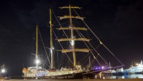 Sailing yacht RUNNING ON WAVES -  At Night