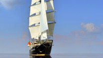 Sailing yacht RUNNING ON WAVES -  At Sea