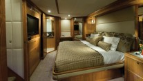 The 75 superyacht  master stateroom  with full beam king-sized bed