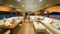 The 75 superyacht aft galley and saloon with L-shaped lounge
