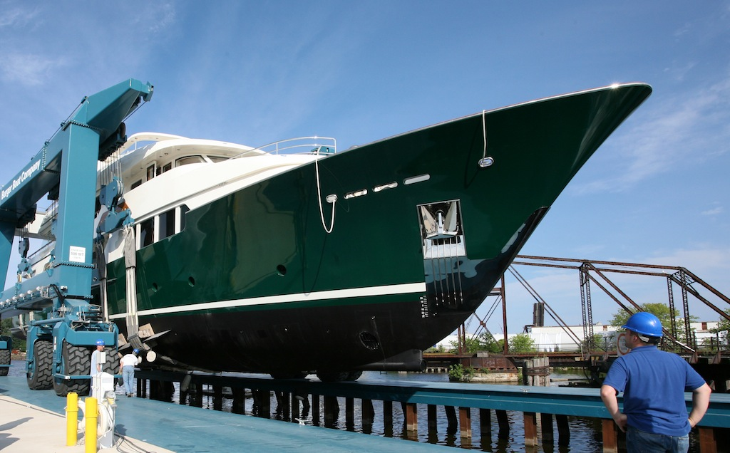 Distinctive green hull of the my sea owl image courtesy for Green boat and motor