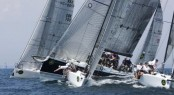 Bella Mente rounds the weather mark in a pack of Melges 32s - Photo Rolex/Dan Nerney