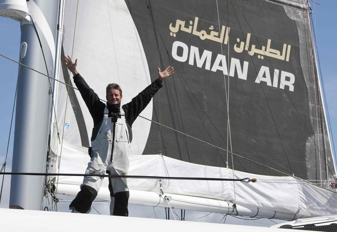 Sidney Gavignet (FRA) celebrates breaking the Round Britain and Ireland Record onboard Oman Air Majan Photo Credit Mark Lloyd