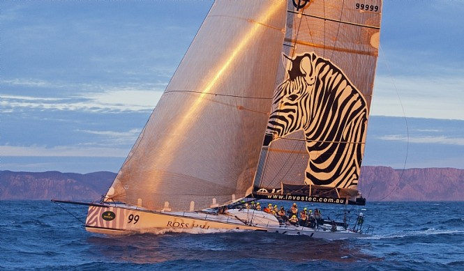 INVESTEC LOYAL catches the sunset off Tasman Island - Photo credit Rolex  Daniel Forster