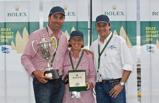 Line Honours Prizegiving Ceremony From L-R Mark Richards, skipper of WILD OATS XI, Adrienne Cahalan, co-navigator of WILD OATS, and Patrick Boutellier, Rolex Australia Photo credit Rolex  Carlo Borlenghi