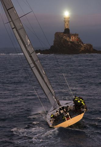 Overall winner, sailing yacht Rán, at the Fastnet Rock. Photo Rolex  Carlo Borlenghi