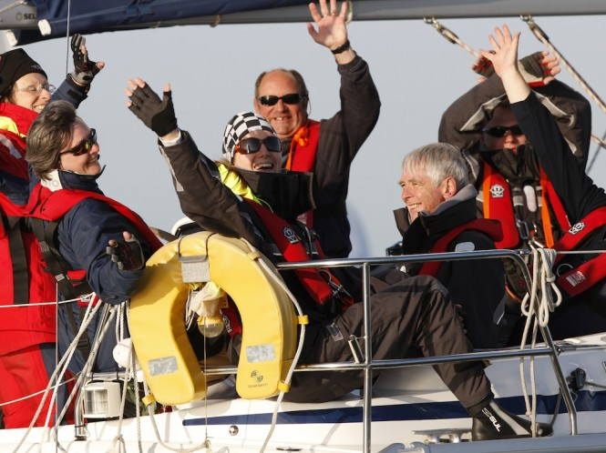 Happy smiling people racing aboard LAITA in 2010 - Credit Paul Wyeth