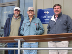 From left, Peter VanLancker, Bob Price and Todd Taylor stand in front of Hunt Yachts' new Chesapeake office.