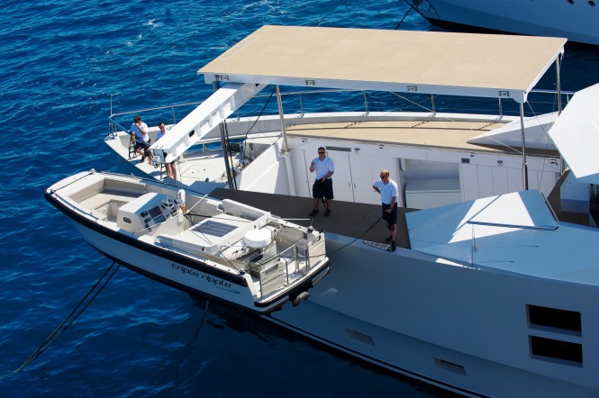 Tender Launching on the bow of motor yacht Big Fish