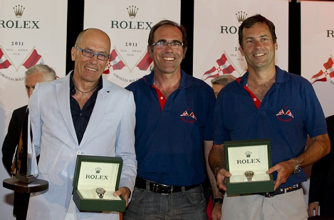 Igor Simcic, owner of ESIMIT EUROPA 2, Michel Heyraud and Dominique Heyraud owners of FOXY LADY, winners of the 2011 Giraglia Rolex Cup     Photo credit Rolex  Carlo Borlenghi