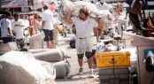 Crews carrying the sails after training - Photo Pedro Martinez - Audi MedCup - Region of Sardinia Trophy 2011