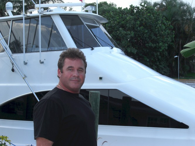 IAG Yachts recruit Dave Adams of Tricon Marine - Photo of Dave in front of Ocean 60' motor yacht