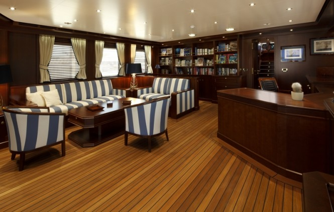 Upper Salon with of Yacht Axantha II with a large lounge, study, library - Photo Credit B. Muncke  JFA