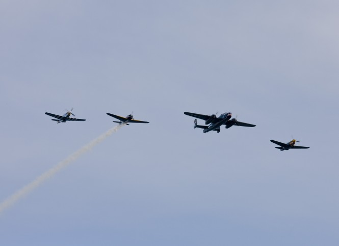 A collection of WWII aircraft performing crowd pleasing aerobatics following the 2011 Shipyard Cup -  Photo by Billy Black