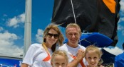 Russell Ingall and family hoist the giant X flag to mark the opening of the Gold Coast Marine Expo