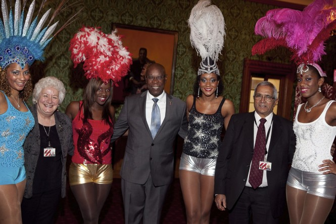 Baroness Harris of Richmond, His Excellency Hugh Arthur, Barbados High Commissioner to the UK, and Lord Dholakia with the Barbados Tourism Authority's Carnival Girls. Credit The Barbados Tourism Authority