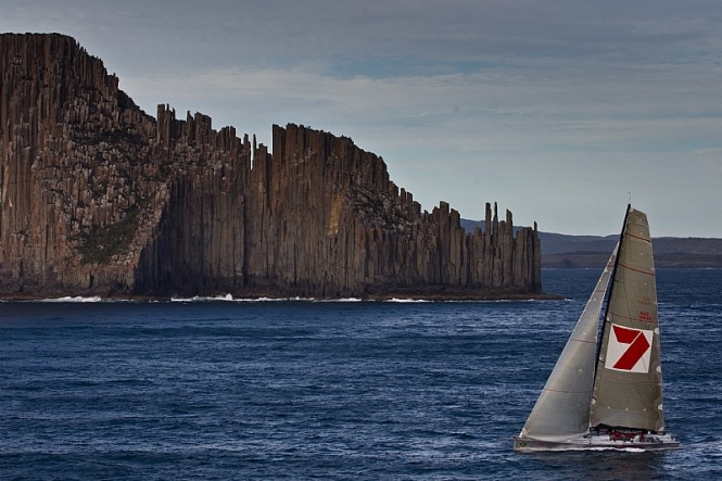 Line Honours Winner sailing yacht WILD OATS XI passing Tasmania's iconic Organ Pipes Photo By Rolex  Carlo Borlenghi