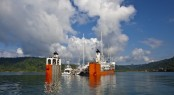 Dockwise Yacht Transport�s (DYT) bright orange semi-submersible ship, Super Servant 4, picks up yachts in Golfito, Costa Rica before heading to Brisbane, Australia. (Photo credit Onne van der Wal)