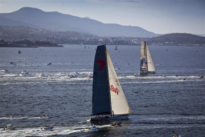 Super maxi sailing yachts INVESTEC LOYAL and WILD OATS XI close to the finish line on the Derwent River Photo: ROLEX/D. Forster