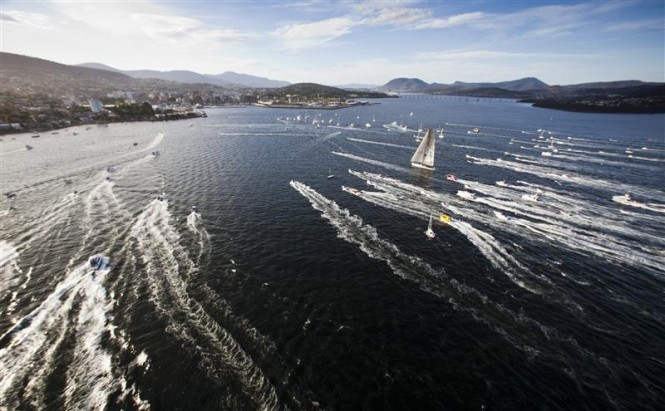INVESTEC LOYAL Superyacht escorted by spectator craft before crossing the finish line Photo: ROLEX/D. Forster