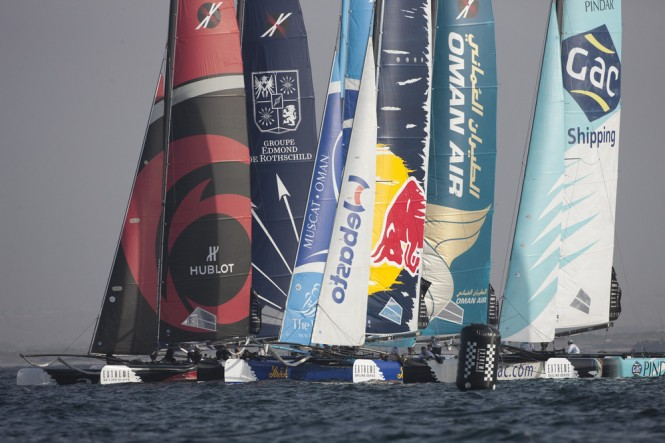 Extreme 40 yachts racing on the first day of racing in Muscat Credit: Lloyd Images