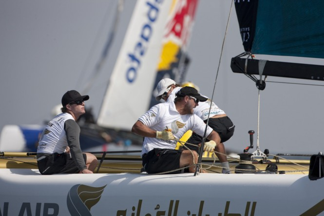 Morgan Larson at the helm of the sailing yacht Oman Air on day 1 Credit: ...
