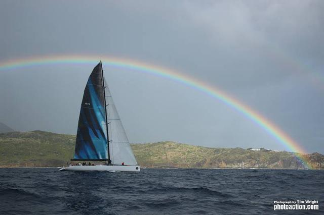 RORC Caribbean 600, 2012. Med Spirit under a rainbow off St Martin on Tuesday 21st February - Credit: RORC Caribbean 600/Tim Wright/Photoaction