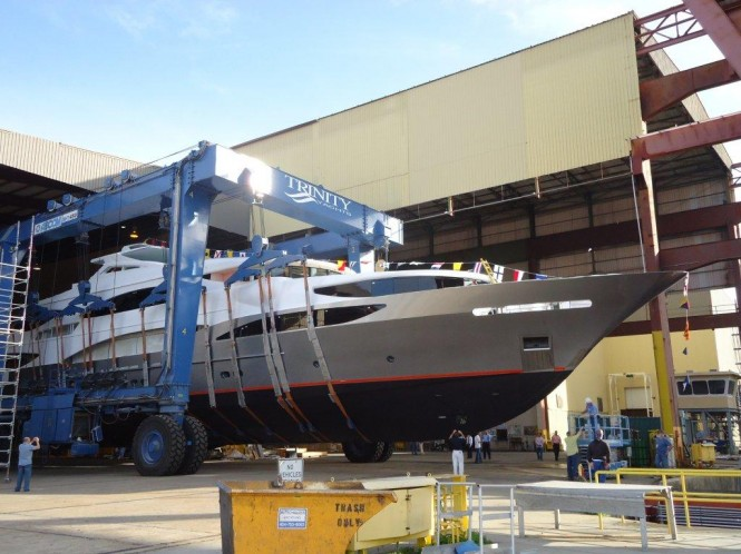 TSUMAT, Trinity Yachts T057, Bedecked in Flags, Ready to Splash - Photo Credit Trinity Yachts