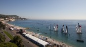 Extreme Sailing Series fleet racing only a few meters from the beach in Nice Credit Lloyd Images