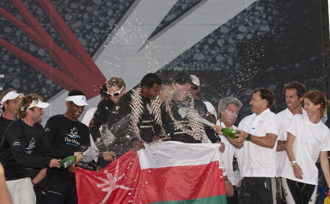 Leigh McMillan and Pierre Pennec spray champagne over winning skipper Morgan ...