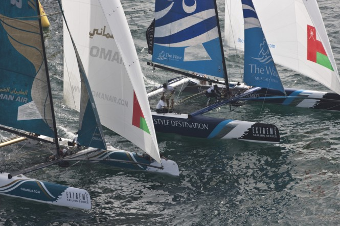 Sailing yachts Oman Air and The Wave, Muscat in close quarter battle during racing Credit Lloyd Images