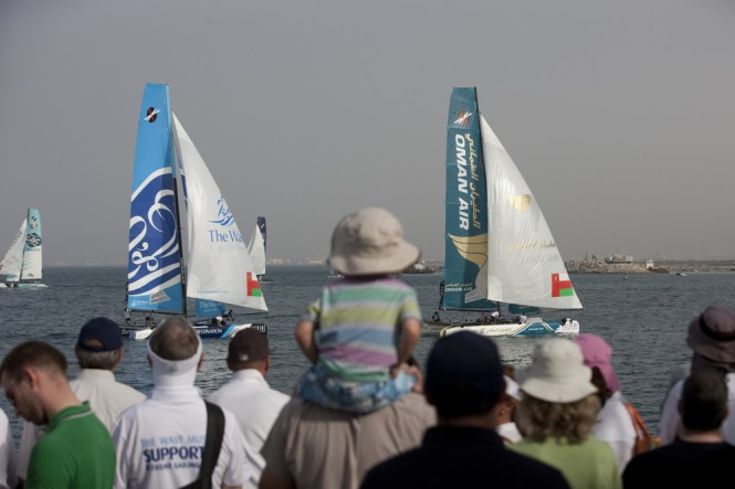 Spectators watching the racing with the yachts Oman Air and The Wave, Muscat leading the fleet Credit Lloyd Images