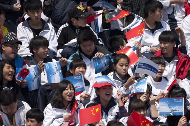 Chinese school children enjoying the racing on the first day in Qingdao