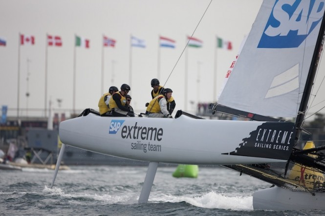 SAP Extreme Sailing Team flying a hull on day 2 in Qingdao - Image credit Lloyds Images