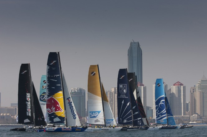 The Extreme 40 fleet racing in front of the impressive skyline in Fushan Bay, Qingdao Credit: OC Thirdpole