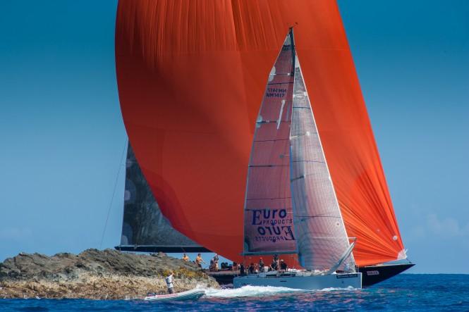 Sailing yacht Water World vs Superyacht Dragon around  Jaguar Island © Christophe Jouany