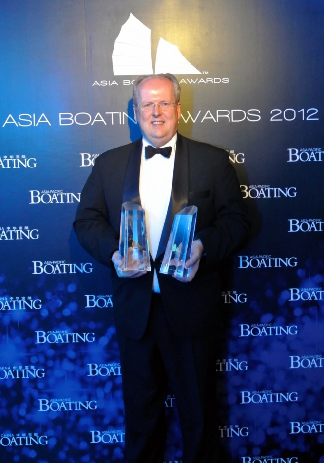 Royal Hong Kong Yacht Club General Manager, Mark Bovaird collects both awards
