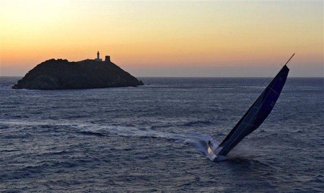 100ft superyacht Esimit Europa 2 passes the Giraglia rock at sunset Credit RolexKurt Arrigo