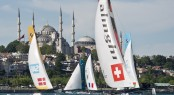 Alinghi in the lead on the downwind leg during racing on Day 1 in Istanbul