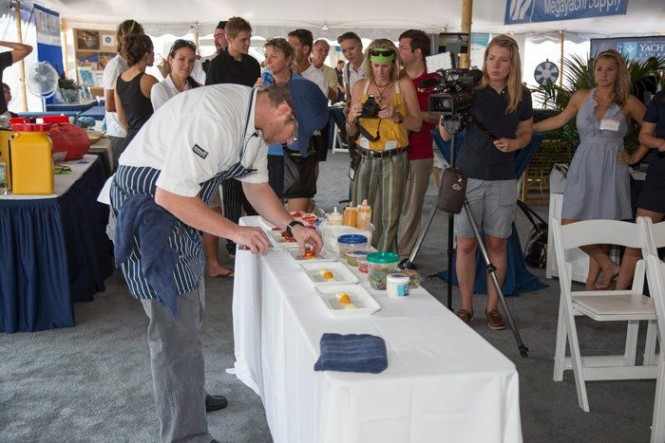 Competitor in the Grande Class prepares his dish for judges. Photo Credit: Billy Black