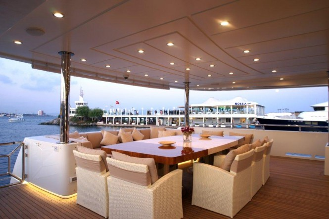 Luxurious exterior aboard the 45m superyacht Tatiana - al fresco dining area