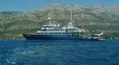 Golden Shadow superyacht at anchor off the Croatian coast, showing the seaplane 'Golden Eye' on her stern platform