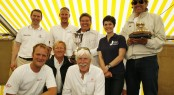Roger Thompson, J.P. Morgan Asset Management (left) with the winning crew of �Manroland Sheetfed� and Tony Langley holding the Gold Roman Bowl, presented by Dame Ellen MacArthur at today�s prizegiving at the Island Sailing Club in Cowes. Photo: Patrick Eden