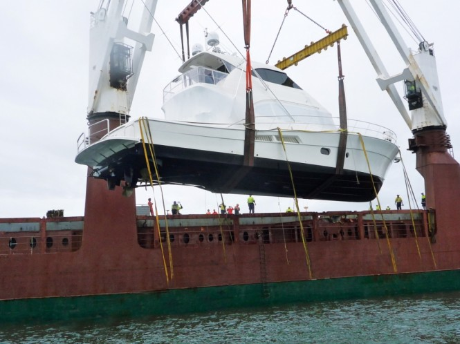 Riviera's first 75 Enclosed Flybridge is loaded onto a ship bound for New Zealand