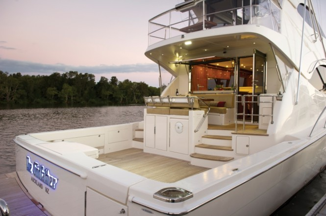 The luxury yacht 75 Enclosed Flybridge's large cockpit is excellent for sport fishing and entertaining