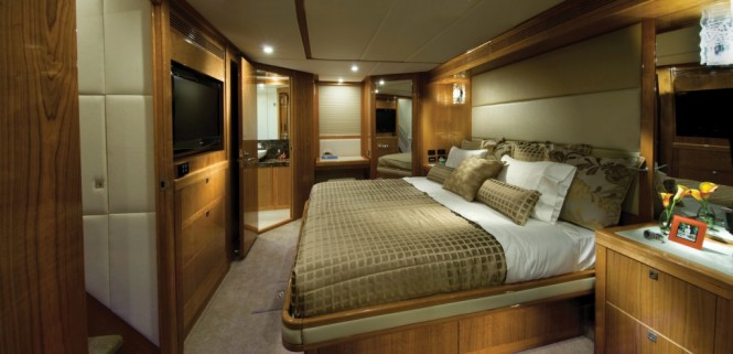 The 75 yacht has four cabins each with its own ensuite including the master stateroom (pictured) with full beam king-sized bed