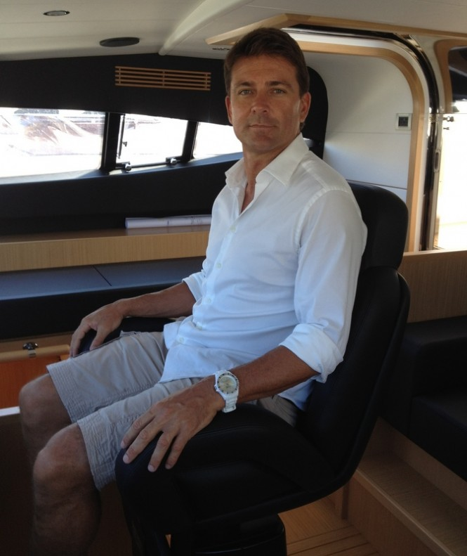 Josh Lee in the cockpit of the Ferretti 881 RPH superyacht